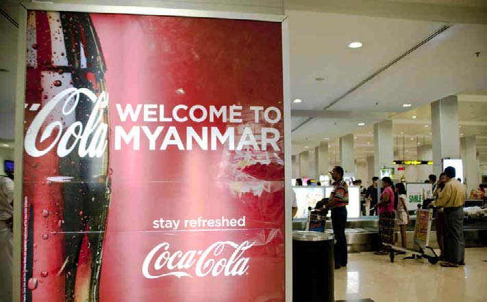 A Coca-Cola advertisement in the baggage claim area at the Yangon Airport in Myanmar. | photo : npr.org