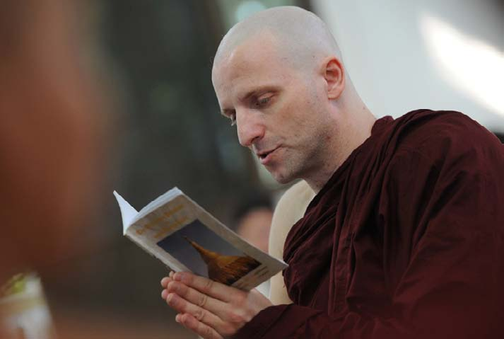 British art historian, Rupert Richard Arrowsmith recites the teachings of Buddha during an ordination ceremony at a monastery on the outskirts of Yangon. Pre-dawn wake-up calls, days of silence and hunger may not be everyone's idea of a holiday, but for tourists seeking spiritual sustenance Myanmar's monasteries offer help on the path to Buddhist nirvana. Photograph: AFP Photo / Soe Than Win