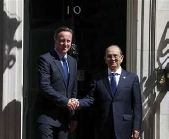 Britain's Prime Minister David Cameron greets the President of Myanmar Thein Sein in Downing Street, central London July 15, 2013. photo: reuters/andrew winning