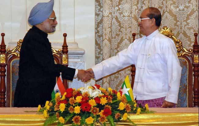 Visiting Indian Prime Minister Manmohan Singh (L) shakes hands with Myanmar President Thein Sein during their meeting at the President's house in Naypidaw on May 28, 2012. India's prime minister signed a host of agreements with Myanmar on May 28th in a historic visit aimed at boosting trade and energy links and contesting the influence of regional rival China. | photo: globalpost.com