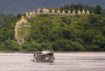Golden spires of Massein monastery are seen on the banks of Myanmar's upper Chindwin river photograph: cynthia nejame