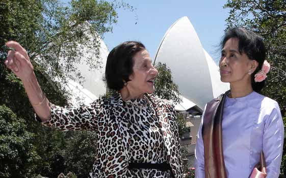 Myanmar pro-democracy leader Aung San Suu Kyi, right, poses with New South Wales state governor Marie Bashir at Government House in Sydney | photo: rick rycroft