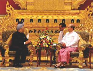 MYANMAR PRESIDENT U THEIN SEIN, RIGHT, TALKS WITH INDIAN PRIME MINISTER MANMOHAN SINGH