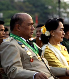 In what's seen as a highly symbolic gesture, pro-democracy icon Aung San Suu Kyi seen attending Myanmar's 68th Armed Forces Day Parade on March 27 for the first time. Seen here seated alongside Major General Zaw Win, Deputy Minister for border affairs