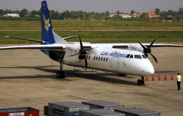A Lao Airlines airplane is parked at the tarmac of Vientiane's airport in this file photo from 2011. The Lao national carrier will begin direct flights to Myanmar in October after a two-decade absence of air links between Vientiane and Yangon | Photo: Reuters