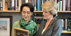 AUSTRALIA'S FOREIGN MINISTER JULIE BISHOP INTERACTS WITH DAW AUNG SAN SUU KYI