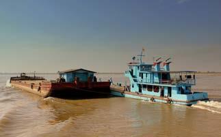 BARGE IN THE AYEYAWADY RIVER, MYANMAR