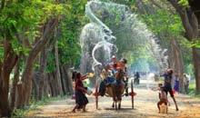 CHILDREN CELEBRATING THINGYAN WATER FESTIVAL ON THE STREETS OF MYANMAR