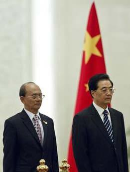 MYANMAR'S PRESIDENT THEIN SEIN, LEFT, AND CHINESE PRESIDENT HU JINTAO STAND FOR NATIONAL ANTHEMS DURING A WELCOME CEREMONY AT THE GREAT HALL OF THE PEOPLE IN BEIJING, CHINA
