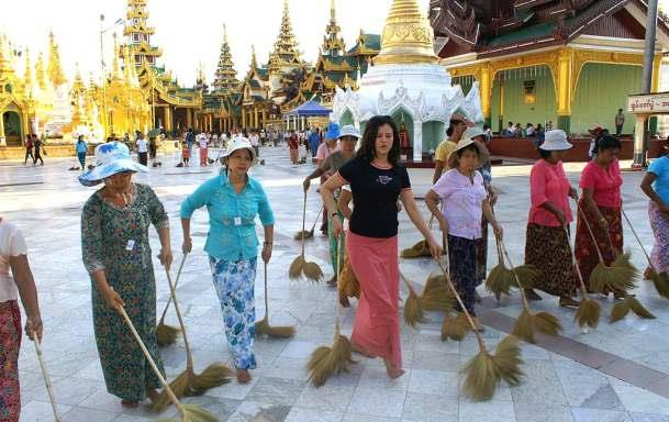 SEVERAL TIMES A DAY, BURMESE WOMEN WORK IN GROUPS TO CLEAN THE SHWÉDAGON PAGODA IN YANGON