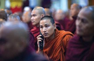 MOBILE REVOLUTION IN MYANMAR - MONK USING A MOBILE PHONE