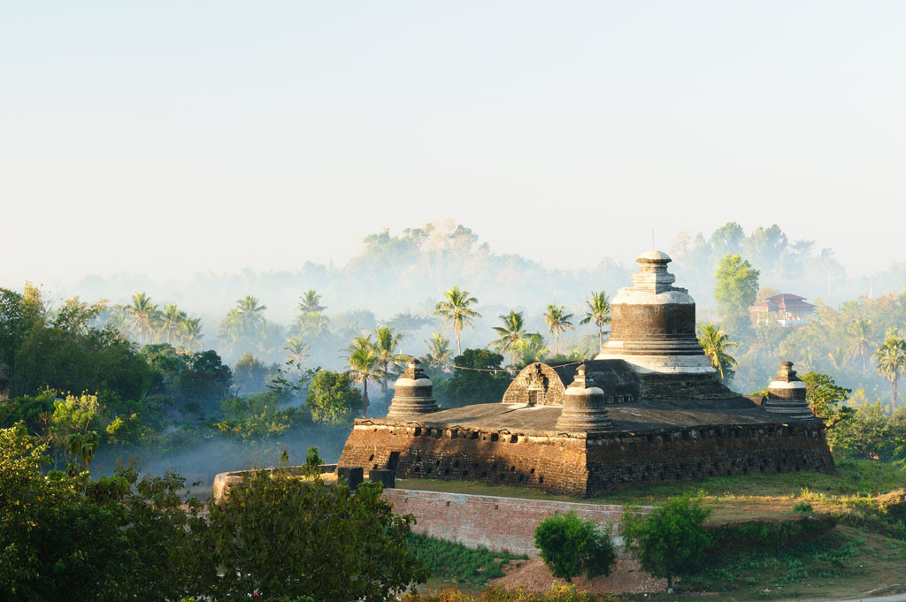 Myanmar (Burma), Mrauk U temples. Dukkanthein Paya - built by King Minphalaung in 1571 in particulary troubled times, Dukkanthein's interior features spiralling cloisters lined with images of Buddha and, as per astrologers' strategic advice to the king, of common people, landlords, governors, officials and their spouses, who famously show off all of Mrauk U's 64 traditional hairstyles.