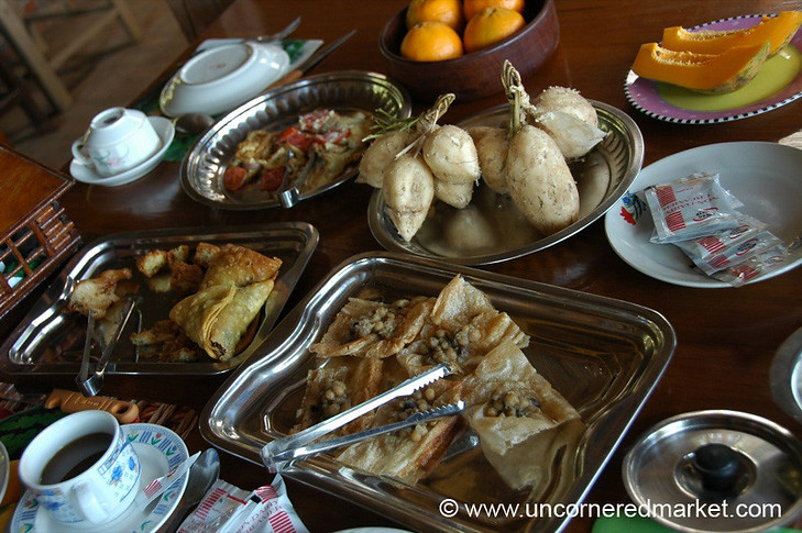 The Myanmar Beauty Guesthouse in Toungoo, Burma (Myanmar) serves a delicious - and abundant - breakfast each morning: samosas, fresh fruit from the garden, eggs, toast, and much more. It was so much that we took much of it with us to eat throughout the day.