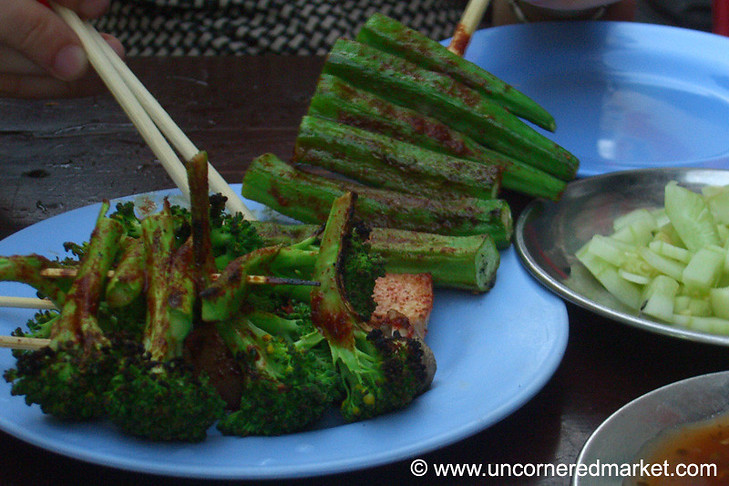 Spicy, grilled okra and broccoli make for a delicious and light dinner on the barbecue streets of Rangoon's Chinatown between Mahabandoola and Anawrahta Streets...Taken in Rangoon, Burma (Yangon, Myanmar).