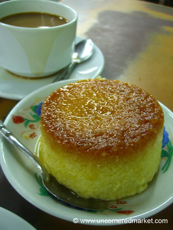As you walk towards Sule Paya in Rangoon (Yangon), follow the coffee smell to this hole-in-the-wall cafe on Sule Paya Road with delicious sweet coffee and melt-in-you-mouth flan with a perfect brown crust on top. ..Two coffees and a flan cost a grand total of $0.80.