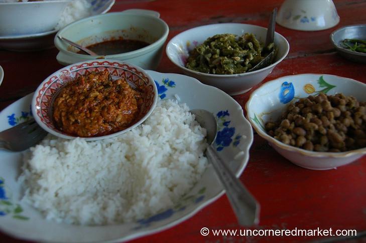 Varieties of vegetarian curries and dishes at a local Burmese street restaurant down the street from the Teak Monastery in Mandalay, Burma (Myanmar).