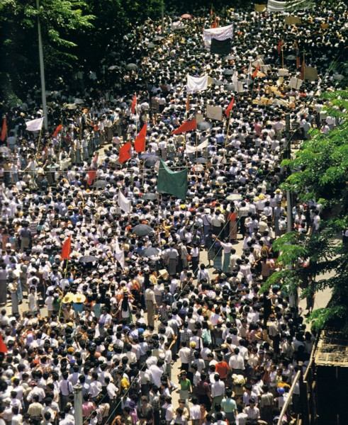 "Demonstrations broke out across the country during the so-called ""Democracy Summer"" that followed. But on August 8, 1988 troops began a four day massacre, firing into crowds of men, women and children gathered in Rangoon. At least 10,000 demonstrators were killed across the country."